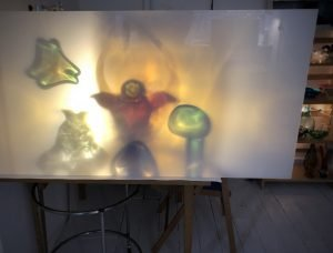 Light through glass projected onto perspex